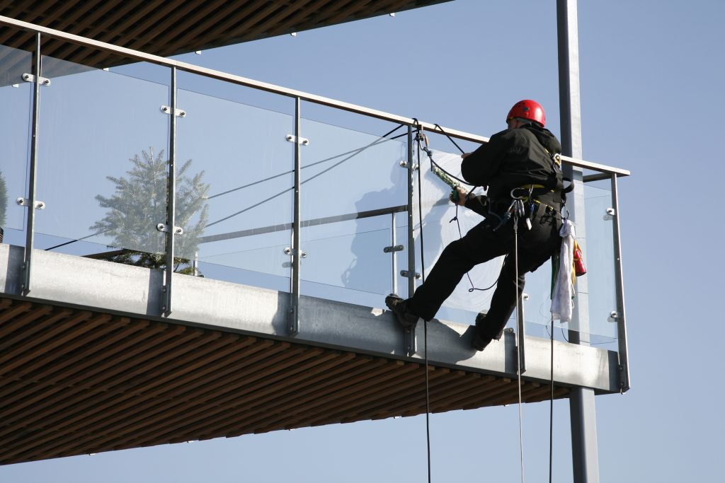 cleaning_glass_balustrade