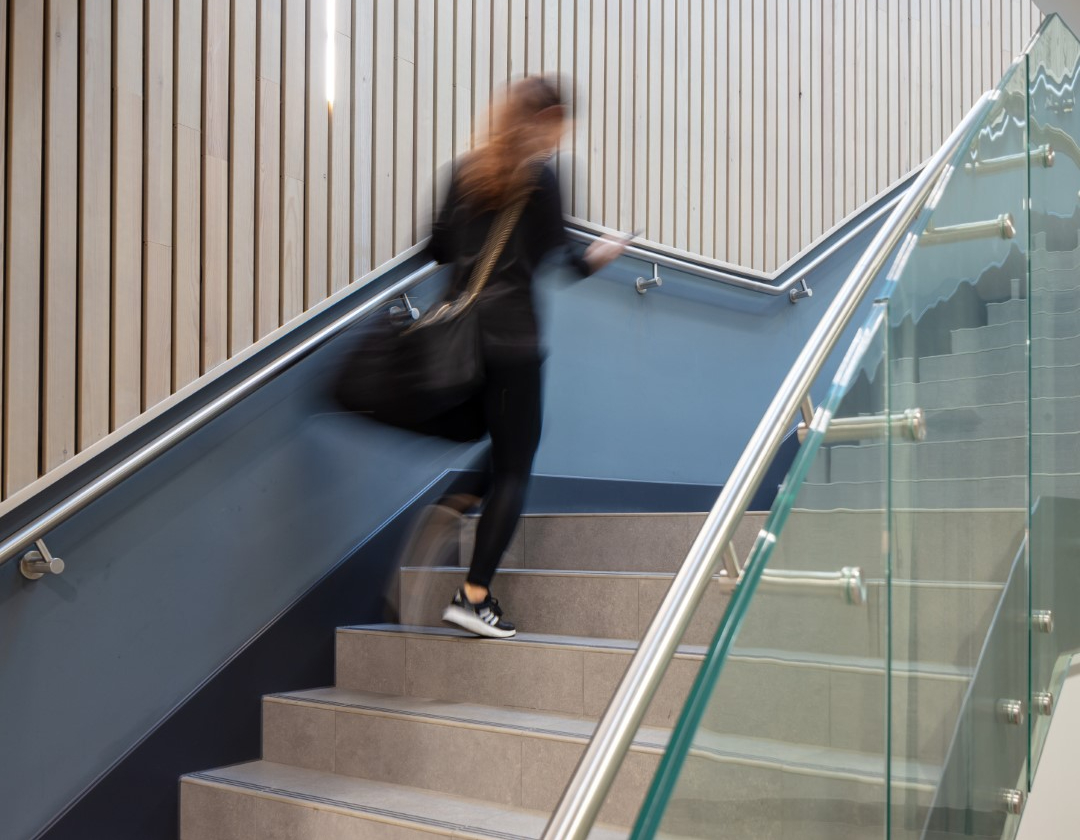07 person walking up main stair